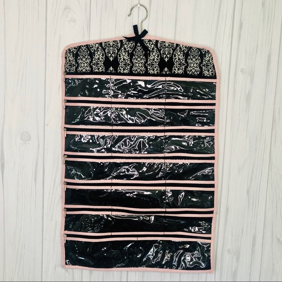 Hanging jewelry organizer in black and white
